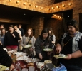Actors and students gather greek food for themselves at the Lysistrata play meet-and-greet on March 5th in the Fain art building lobby. Photo by Kayla White.
