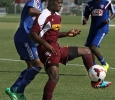 Hindowa Momoh, psychology freshman, tries to get the ball past FC Dallas defenders at Moneygram Soccer Park in Dallas Saturday afternoon. The match ended 2-0. Photo by Lauren Roberts
