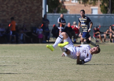 Defender Alex Mullet goes down hard in the Heartland Conference championship game aginst St. Edward's University. MSU won 1-0. Mullet was not injured. Photo by Bradley Wilson