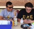 Frank Cruz, marketing junior, and Enrique Flores, biolog sophomore, wait for students to check in at the McCullogh-Trigg Check in point on Move In Day, Tuesday August 18, 2015. Photo by Rachel Johnson