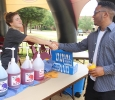 Ashley Burkhart, intern at the Baptist student Ministry, introduces herself to Tyre Browning, nursing freshman, at the free snowcone stand, provided by the BSM, under the big MSU tent on the greem space, during Move In Day Tuesday, August 18, 2015. Photo by Rachel Johnson