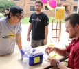 James Huynh, nursing junior, helps Clint Coulter, residence hall director, search through the Pierce resident's keys for a new student at Move In Day, Tuesday, August, 18, 2015. Photo by Rachel Johnson