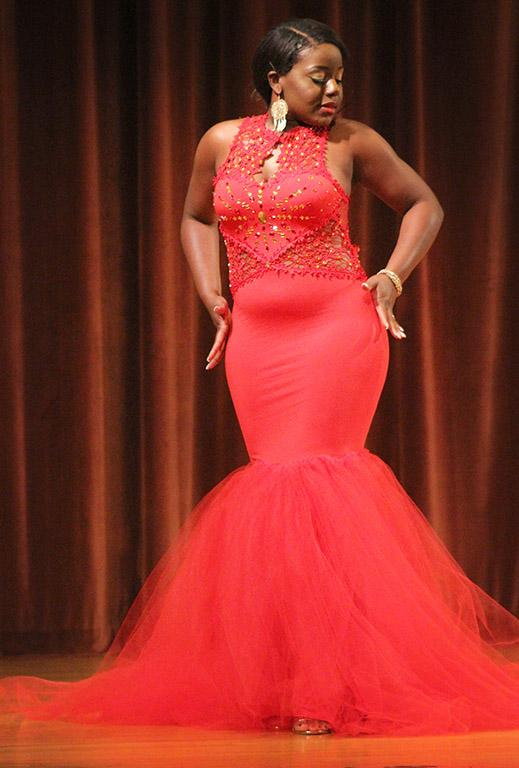Valandra Jno Marie, management freshman, feels her hands down the curve of her dress during the evening wear portion of the 2017 Mr. and Miss Caribfest Pageant held in Akin Auditorium Sept. 28. Photo by Marissa Daley
