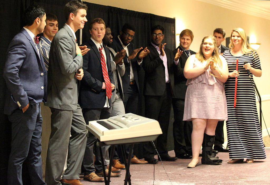Contestants of Mr. Heartthrob applaud  Coleman Reidling, history junior, after being named spring of 2016 Mr. Heartthrob in Comanche suites on April 30.Photo by Makayla BUrnham