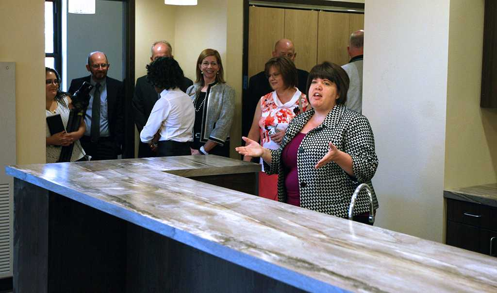 Kristi Schulte, housing director, gives details about the Faculty-in-Residence apartment in Legacy Hall to the Board of Regents during a walk-through on Aug. 4.