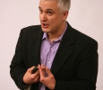 """Peter Boghossian, philosophy instructor at Portland State University, spoke in Dillard auditorium May 1 at 7 p.m. About 120 people attended the free lecture, """"Jesus, the Easter Bunny, and Other Delusions: Just Say No!"""" Photo by Connor Bennett"""