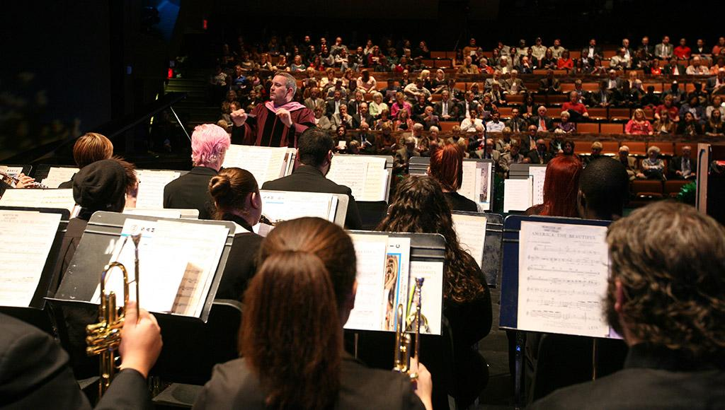Matt Luttrell directs the wind ensemble at the inauguration of Suzanne Shipley, university president, Midwestern State University, Dec. 11, 2015. Photo by Bradley Wilson