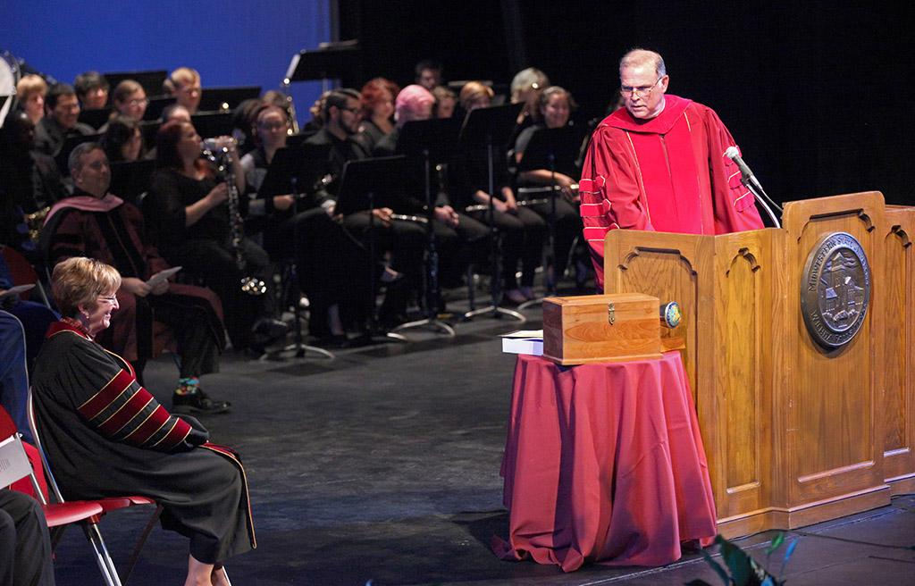 Shawn Hessing, chairman in the board of regents, congratulates Suzanne Shipley, university president, at the Presidential Inauguration in Fain Fine Arts Center Theatre, Dec, 11, 2015. Photo by Francisco Martinez