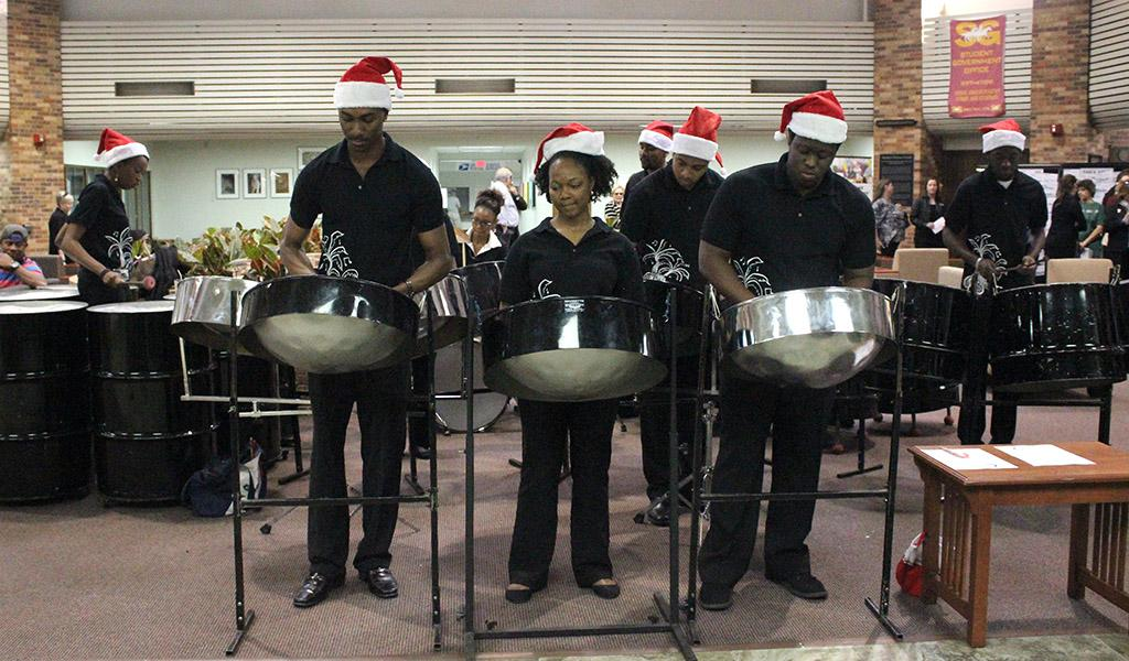 The Caribbean Steel Pan performed a variety of musical numbers in the CSC Atrium during the Holiday Luncheon following the Inaguration of Suzanne Shipley, the eleventh president, held in Fain Fine Arts Auditorium, Dec. 11. Photo by Rachel Johnson