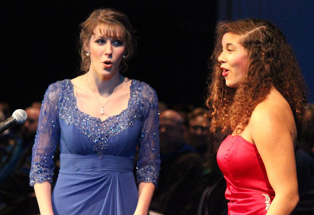 """Lindy Wilson, vocal performance post grad, and Sharon Mucker, music education junior, perform """"Prendero quell brunettino"""" from Cosi fan tutte by W.A. Mozart for the Inaguration of Suzanne Shipley, the eleventh president, held in Fain Fine Arts Auditorium, Dec. 11. Photo by Rachel Johnson"""