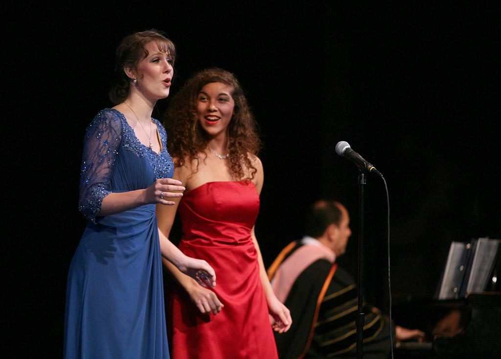 """Sharon Mucker and Lindy Wilson sing """"Prendero quell brunettino"""" at the inauguration of Suzanne Shipley, university president, Midwestern State University, Dec. 11, 2015. Photo by Bradley Wilson"""