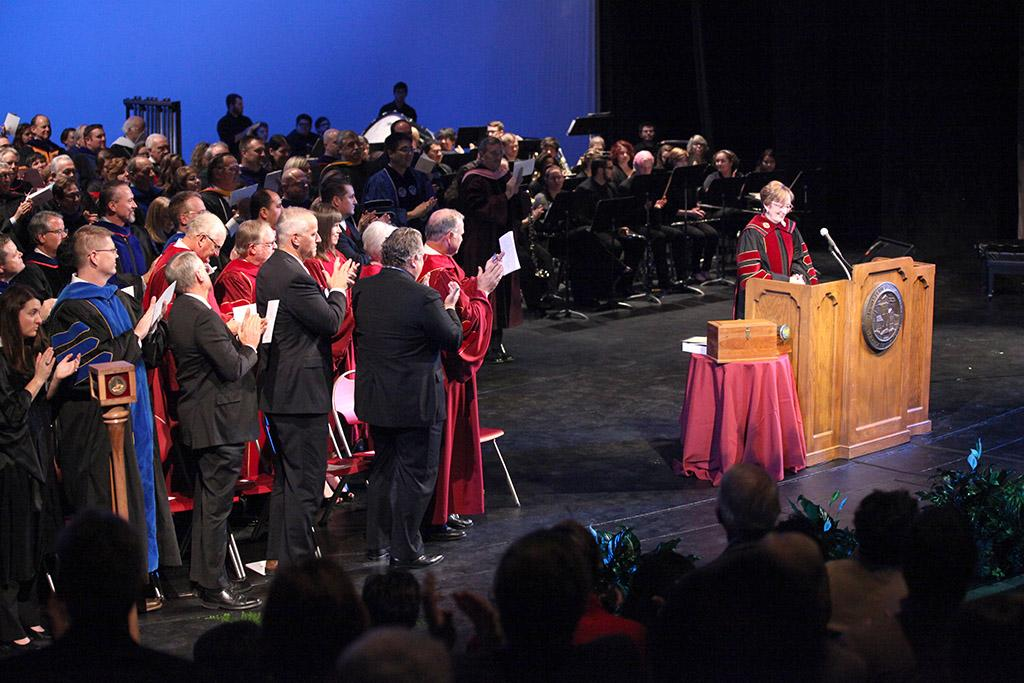 Audience members, and  faculty, congratulate Suzanne Shipley, university president, before her presidential address at the Presidential Inauguration in Fain Fine Arts Center Theatre, Dec, 11, 2015. Photo by Francisco Martinez