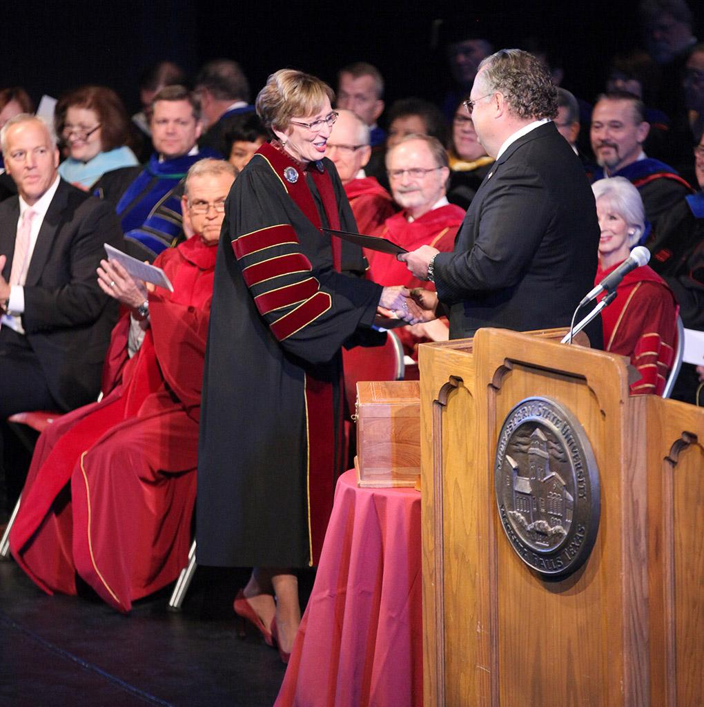 Craig Estes, Texas state senator, hands Suzanne Shipley, university president, a gift at the Presidential Inauguration in Fain Fine Arts Center Theatre, Dec, 11, 2015. Photo by Francisco Martinez
