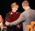 """Jesse Brown, criminal justice senior, hugs Suzanne Shipley after his """"Greetings from the students"""" speech about President Suzanne Shipley at the Inaguration of Shipley, the eleventh president, held in Fain Fine Arts Auditorium, Dec. 11. Photo by Rachel Johnson"""