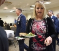 Mary Lassetter, administrative assistant for the office of residence life, gets food from the Holiday Luncheon held in CSC Comanche Suites after the Inaguration of Suzanne Shipley, the eleventh president, held in Fain Fine Arts Auditorium, Dec. 11. Photo by Rachel Johnson