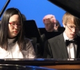"""Nahey Byun, piano performance, and Aaron Johnson, piano performance sophomore, performed an original piece called """"Homage"""" at the Inaguration of Suzanne Shipley, the eleventh president, held in Fain Fine Arts Auditorium, Dec. 11. Photo by Rachel Johnson"""