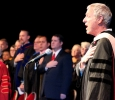 """After Sheppard Air Force Base honor guard performed the presentation of colors, Don Maxwell, music professor, sang """"The Star Spangled Banner"""" to start off the Inaguartion of Suzanne Shipley, eleventh president, held in the Fain FIne Arts Auditorium, Dec. 11. Photo by Rachel Johnson"""
