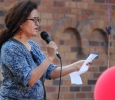 Claudia Montoya, associate spanish professor, gives her speech to the crowd about how they should rise above hate and that love is the real way to go about things as apart of the Resist Hate Rally held in Sunwatcher Plaza Sept. 1. Photo by Rachel Johnson