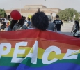 Shaniece Dutch , sociology senior, holds up a pride flag with the word peace on it during the march at the resist hate rally held at the Sunwatcher Plaza on Sept. 1. Photo by Justin Marquart