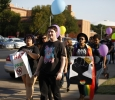 Zarya Maitao, mass communication sophmore, Jessie Tidwell, science education sophmore, and Zaquera Wallace, biology junior, flashes color and march in the Resist Hate Rally held in Sunwatcher Plaza on Sept. 1. Photo by Marissa Daley