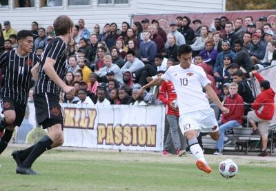 Midfielder and business managment sophomore, attempts a shot a goals against Colorado Mesa University. Nov 12. Photo by Bridget Reilly