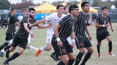 Forward and psychology senior Scott Doney, fends off several players in a corner kick against Colorado Mesa University. Nov 12. Photo by Bridget Reilly