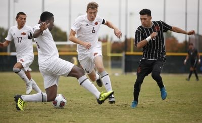 Pierre Bocquet, business senior, and Koby Sapon-Amoah, finance junior, intercept the ball during the NCAA Division 2 South Central Regional game vs Colorado Mesa, where MSU won 3-0, Sunday, Nov. 12, 2017. Photo by Francisco Martinez