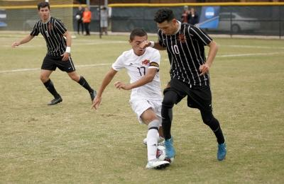 Carlos Flores, sports medicine freshman, cuts off the ball from moving forward during the NCAA Division 2 South Central Regional game vs Colorado Mesa, where MSU won 3-0, Sunday, Nov. 12, 2017. Photo by Francisco Martinez