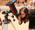 At 12:25 p.m. Amy Chase looks at the solar eclipse watch party Aug. 21, 2017 on Sunwatcher Plaza at Midwestern State University. Photo by Bradley Wilson