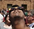 Eric Arumugam, campus visitor, loks up at the sun during the solar eclipse at Sunwatcher Plaza on Aug. 21. Photo by Justin Marquart