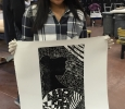 Gabriela Nunez, junior at Hirschi High School, poses with her print, Patterns of the Wind, after pulling it up after getting rolled over to hang in the foyer of Fain Fine Arts, Feb. 9. Photo by Conner Wolf.