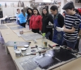Catherine Prose, associate professor, demonstrates to students how to properly roll ink onto the wood block for the Steamroller Print Event on Nocona Trial set up as a collaboration between MSU's Harvey School of Visual Arts and Wichita Falls Independent School District high schools, Feb 9, 2016. Photo by Francisco Martinez