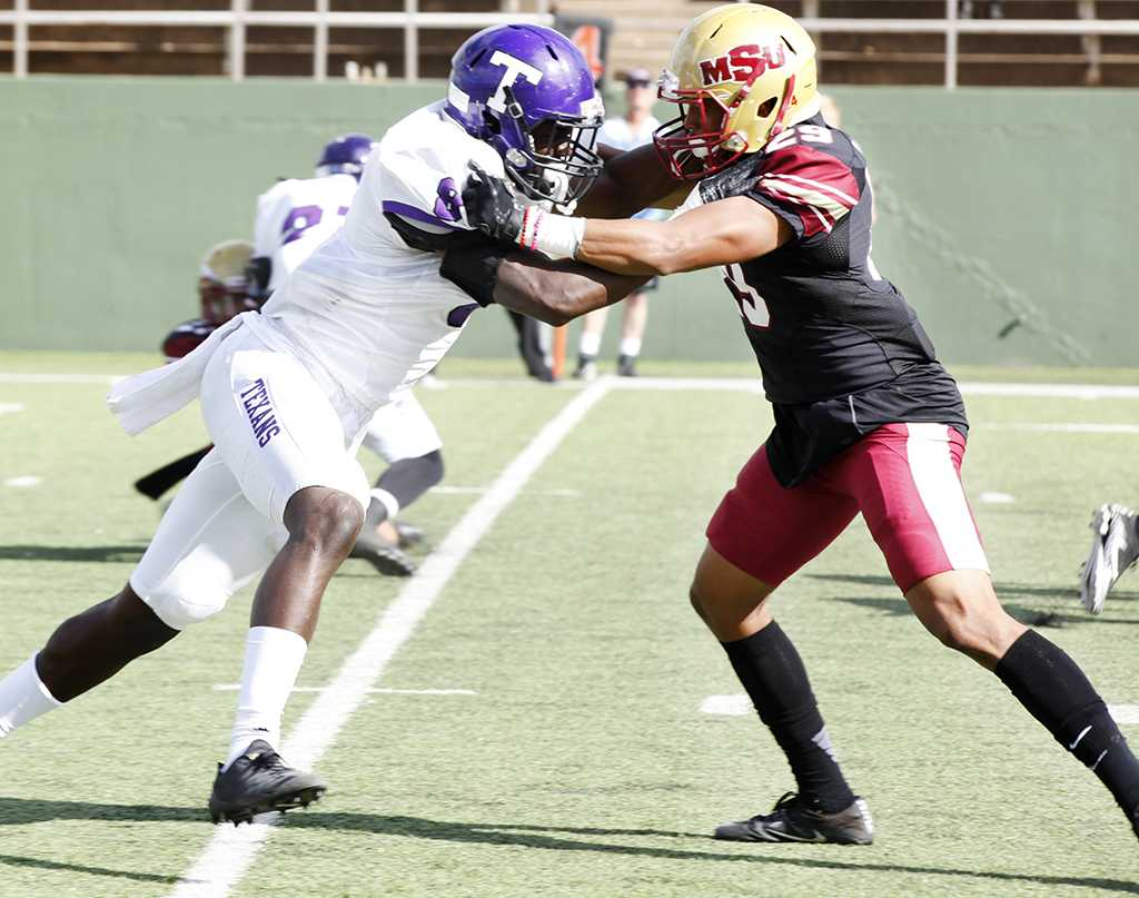 Jakari Domino, music freshman, contributes to the overtime win for the mustangs by blocking an opponent from Tarleton State at Memorial Stadium on Nov. 4, 2017. Photo by Harlie David