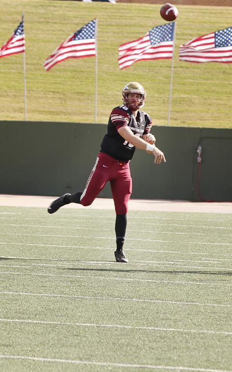 Layton Rabb, accounting junior, throws a pass towards his teammate