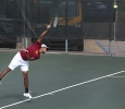 Angel Palacios, business management freshman, serves the ball to the other side during a doubles game against Metro State at the MSU Tennis Center. Photo by Rachel Johnson