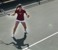 Greta Lazzarotto, management sophomore, returns the ball to the other side during a doubles game against Metro State at the MSU Tennis Center. Photo by Rachel Johnson