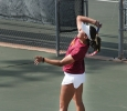 Ashley Ramirez, marketing freshman, serves the ball to the other side during a doubles game against Metro State at the MSU Tennis Center. Photo by Rachel Johnson