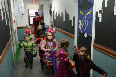 The kids of YMCA trick or treat in Killingsworth Residence Hall at Midwestern State University. Photo by Justin Marquart