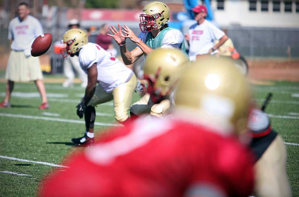 Quade Coward, quarterback, prepares to catch the ball during two-a-day practice Aug. 16. Photo by Bradley Wilson.