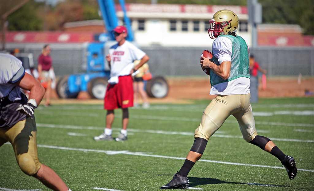 Quade Coward, quarterback, prepares to throw the ball during practice Aug. 16. Photo by Bradley Wilson.