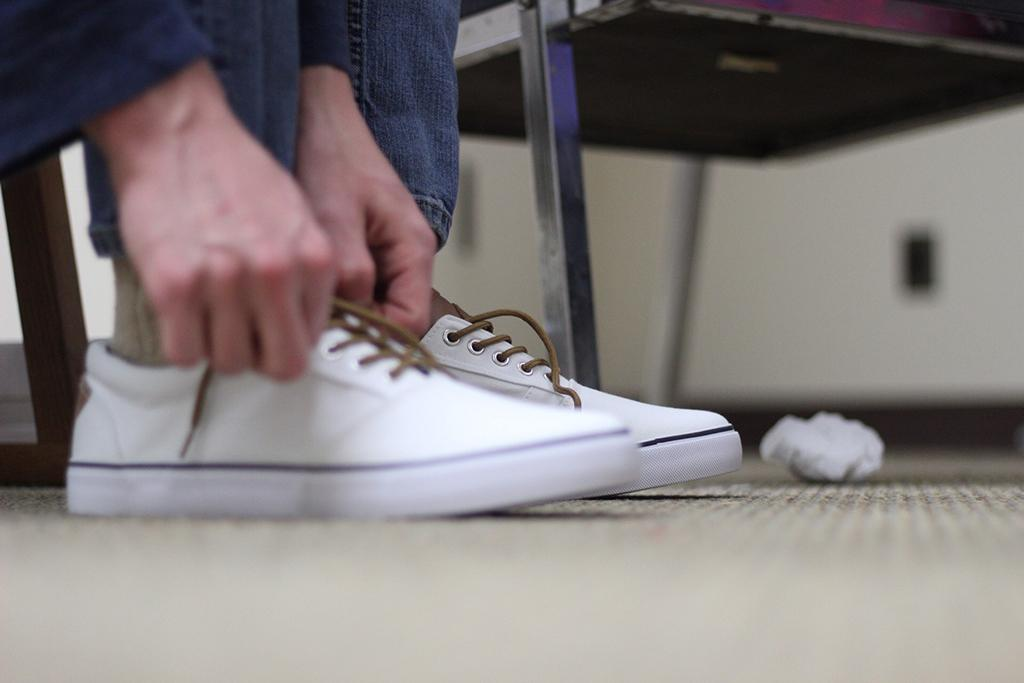 "Sam Mitchell tries on shoes for his costume of ""Bobby"" at the final fittings on Febraury 14. Photo by: Avery Whaite"
