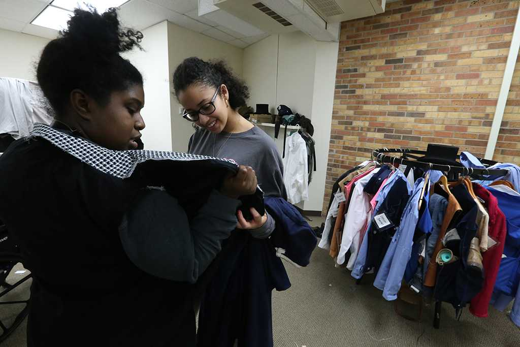 "Kaylor Winter-Roach works with cast members and their costumes in preparation for ""Urinetown"" that opens Feb. 22 at Midwestern State University. Photo by Bradley Wilson"