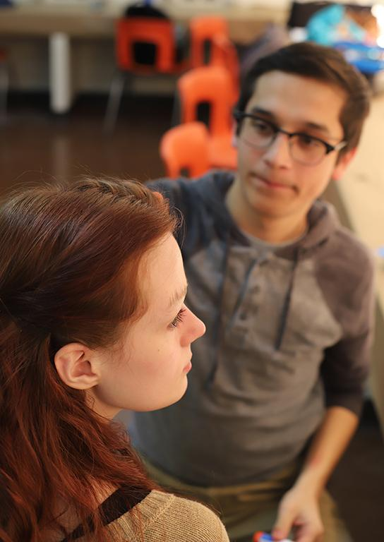 Christopher Cruz, theater junior, teaches, Kalli Root, Little Sally and english junior, how to cover up her eyebrows as part of the make-up design  on Friday, Feb.16, 2018. Photo by Joanne Ortega