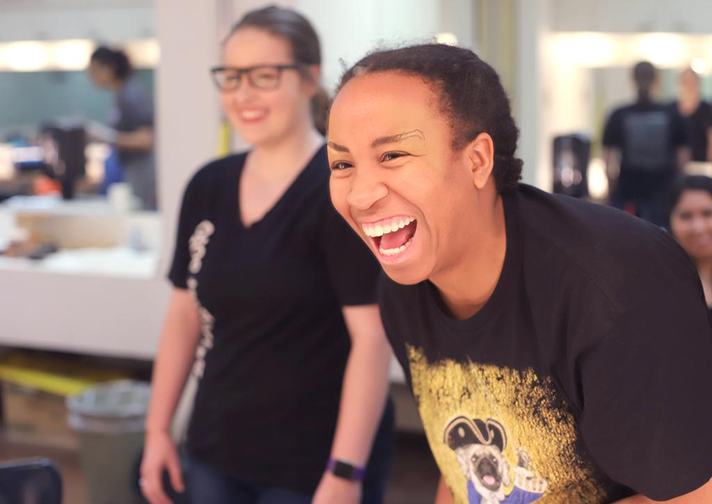 Nicole Smalls laughs after attempting to do her eyebrow makeup for the first time for Urinetown in the dressing room on Feb. 16, 2018. Photo by Sarah Graves