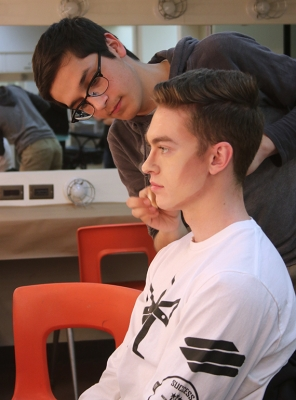 As a way to teach Samuel Mitchell, mass communication sophomore, how to correctly apply his make-up, Christopher Cruz, theater junior, demonstrates how to do it for the first time on Friday, Feb.16, 2018. Phot by Joanne Ortega