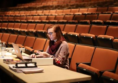 Katie Cagle, stage manager, at the first rehearsal for Urinetown, Jan. 16, 2018. Photo by Bradley Wilson