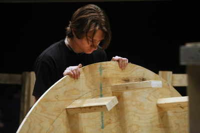 "Ron Harle does woodwork for a pices of the ""Urinetown"" set Jan. 26. Photo by Bradley Wilson"