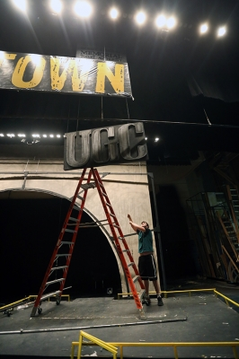 "Joey McGinn helps to take down the set of ""Urinetown."" Photo by Bradley Wilson"