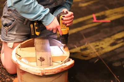"Shae Dorsman, theater junior, removes a ""mushroom,"" as it was called by Dorsman, while striking the Urinetown set on Monday, March 5, 2018. Photo by Jeromy Stacy"