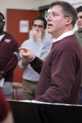 Dale Heidebrecht, assistant music professor, leads the cast of UrineTown through their first rehearsal, Tuesday Dec. 5, 2017. Photo by Rachel Johnson
